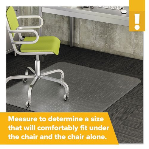 A green and steel office chair rests on a gripped mat designed for low pile carpeting.