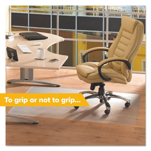 A modern yellow ergonomic office chair on a no-grip chair mat to protect the hardwood floor beneath.