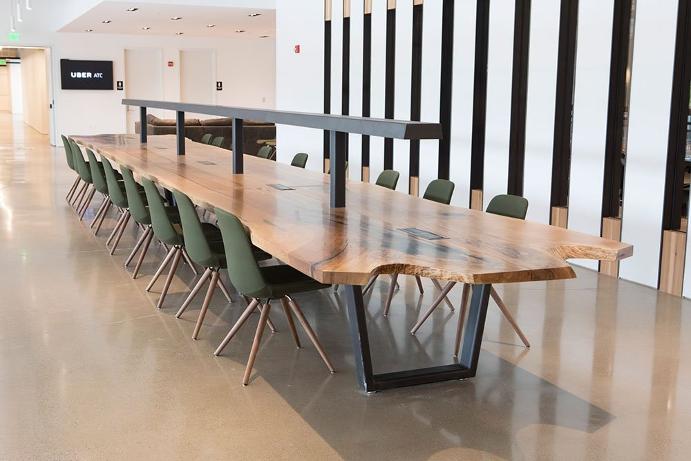 Recycled furniture in your office interior design, like wooden conference tables, make a unique and positive impression.