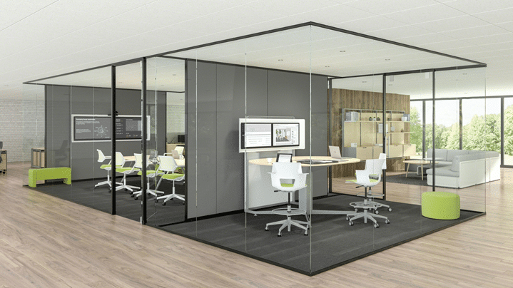 Glass walls in an open office setting to create private meeting spaces.